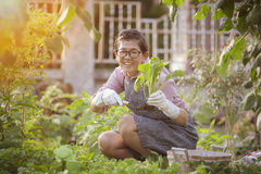 Asian woman happiness emotion relaxing in home gardening activit Royalty Free Stock Photography