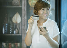 Asian woman happiness smiling face holding credit in hand for sh Royalty Free Stock Images