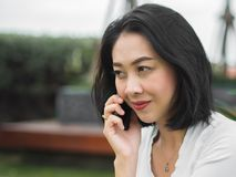 Woman has a good happy mobile phone conversation. stock photo