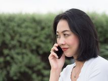 Woman has a good happy mobile phone conversation. royalty free stock image