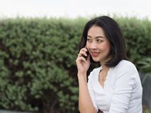 Woman has a good happy mobile phone conversation. stock photography