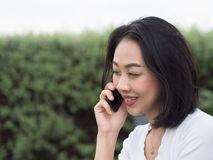Woman has a good happy mobile phone conversation. stock images