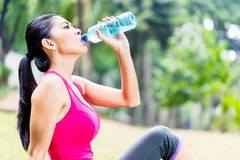Asian woman having break from sport training Royalty Free Stock Images