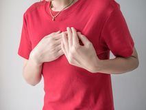 Woman having a heart attack. Asian woman having chest pain - heart attack Stock Photos