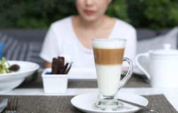 Asian woman having a coffee latte Royalty Free Stock Image