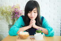Asian woman having cup of coffee and icecream cake in cafe Stock Image
