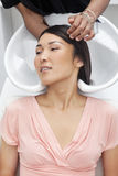 Asian woman having hair wash at beauty salon Stock Photography