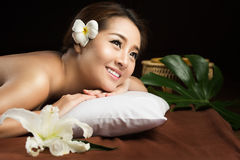 Asian woman having massage and spa salon Beauty treatment concept Stock Photos