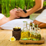 Asian woman having a massage in tropical setting Stock Photography
