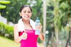 Asian woman having successful sport training Royalty Free Stock Image