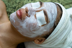 Asian woman having traditional facial spa Royalty Free Stock Photos