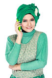 Asian woman with head scarf calling by mobile phone Stock Images