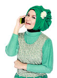 Asian woman with head scarf calling by mobile phone Stock Image