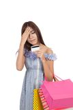 Asian woman headache with credit card and shopping bags. Isolated on white background royalty free stock photo