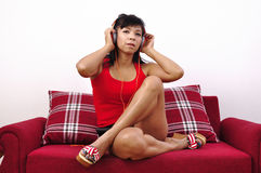 Asian woman with headphone listens to music Stock Photos