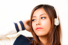 Asian woman and headphone Royalty Free Stock Photos