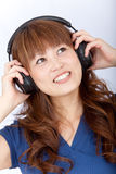 Asian woman with headphones Royalty Free Stock Image