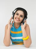 Asian woman with headphones Royalty Free Stock Photos