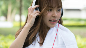 Asian woman with headphones. young female girl listening to musi Royalty Free Stock Photo