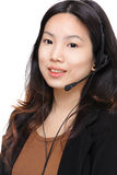 Asian woman with headset Royalty Free Stock Photos