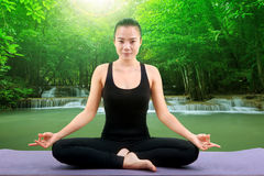Asian woman health care yoga posting  white background Royalty Free Stock Images