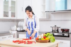 Asian woman, Healthy food at home. Happy family in the kitchen. stock photos