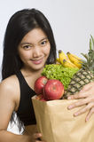 Asian woman with healthy fruits and vegetables Royalty Free Stock Images