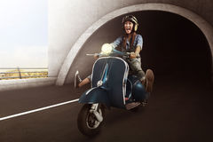 Asian woman with helmet riding scooter Stock Photography