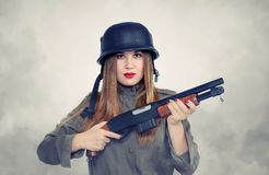 Asian woman in the helmet with shotgun Stock Image