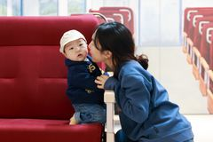 Asian woman and her baby in the old train royalty free stock images