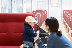 Asian woman and her baby in the old train stock images