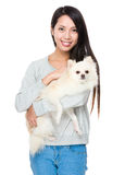 Asian woman with her pomeranian dog Royalty Free Stock Photography