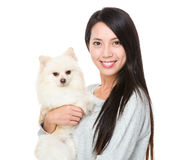 Asian woman with her puppy Royalty Free Stock Photos