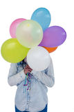 Asian woman hiding her face behind colorful balloons Royalty Free Stock Image