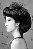 Asian Woman With High Styled Hair Stock Photography