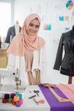 Woman hijab tailor fashion designer. Asian woman with hijab working as tailor and fashion designer Stock Photography