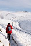 Asian woman hiking in snow Royalty Free Stock Photography