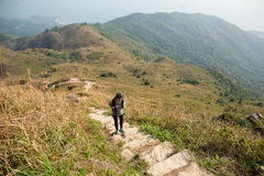 Asian Woman hiking to top of the mountain Royalty Free Stock Photos