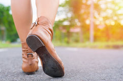 Asian woman hipster walk on road. Woman hipster shoes walk on the road Stock Photos