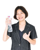 Asian woman hold bottled water on white. Young asian woman hold bottled water isolated on white background Royalty Free Stock Photography