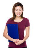 Asian woman hold with clipboard Royalty Free Stock Images