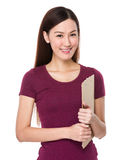 Asian woman hold with clipboard Stock Image