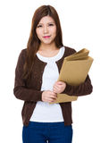 Asian woman hold with folder Royalty Free Stock Photo