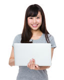 Asian woman hold with laptop Stock Photos