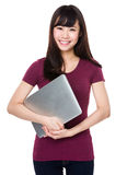 Asian woman hold with laptop Stock Images