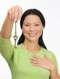 Asian woman hold old key on white Stock Image