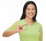 Asian woman hold old key on white Stock Images