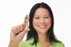 Asian woman hold old key on white Royalty Free Stock Photography
