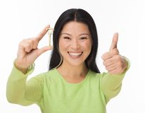 Asian woman hold old key on white Stock Photo