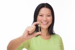 Asian woman hold old key on white Stock Photos